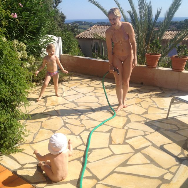 The excitement of playing with a water hose. Priceless!